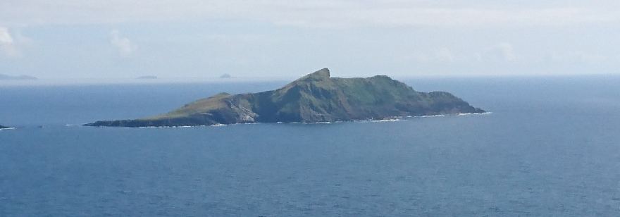 Puffin Island viewed from the north showing Puffin Sound with Bull Rock light in the distanced